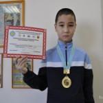 Самый юный спортсмен молодежной команды по тайскому боксу Мангистауской области завоевал золото и чемпионский титул